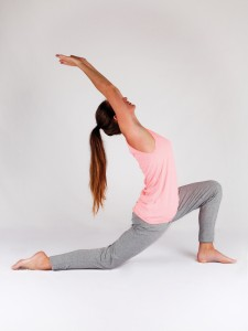 Young woman doing yoga stretching